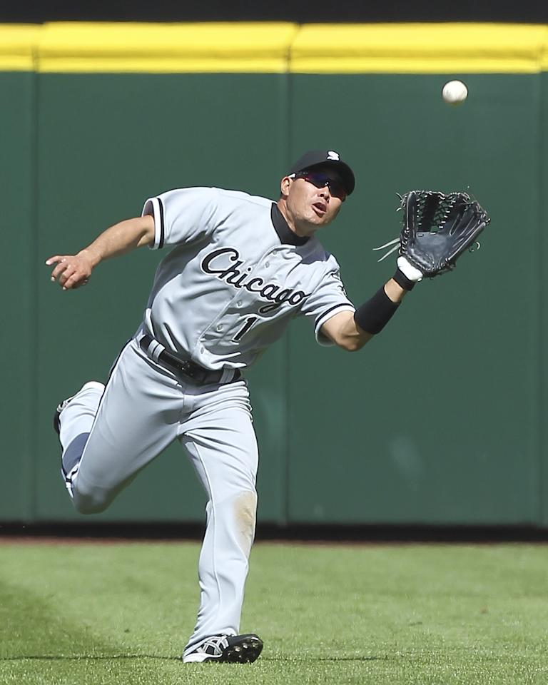 SEATTLE, WA - APRIL 22:  Center fielder Kosuke Fukudome #1 of the Chicago White Sox catches a fly ball by Miguel Olivo of the Seattle Mariners at Safeco Field on April 22, 2012 in Seattle, Washington.The White Sox defeated the Mariners 7-4. (Photo by Otto Greule Jr/Getty Images)