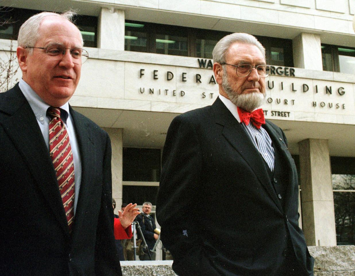 Minnesota Attorney General Hubert H. Humphrey III, left, accompanies former U.S. Surgeon General C. Everett Koop to a  car after Koop sat as a spectator in the courtroom during the state's tobacco trial in St. Paul, Minn., Friday, April 17, 1998. Koop issued a report in 1988 declaring that nicotine in cigarettes is as addictive as cocaine or heroin. (AP Photo/Jim Mone)