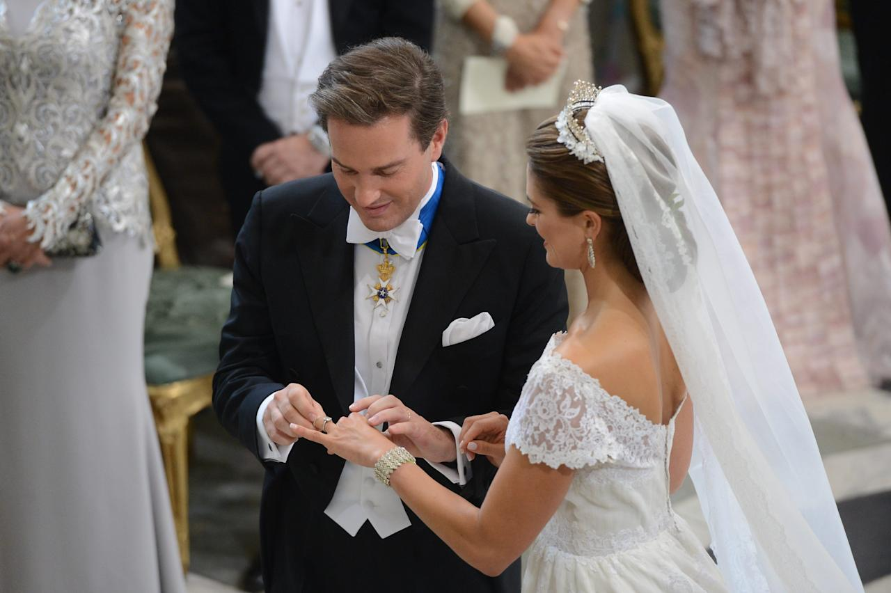 Princess Madeleine of Sweden and Christopher O'Neill during their wedding ceremony at the Royal Chapel in Stockholm, Saturday June 8, 2013. (AP Photo/Fredrik Sandberg) SWEDEN OUT