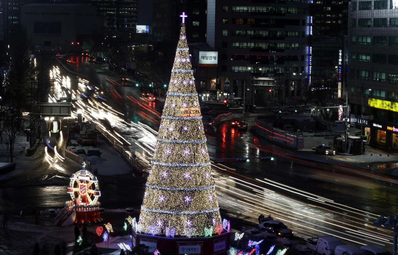 A Christmas tree is lit up to celebrate the upcoming Christmas holiday in front of City Hall in Seoul, South Korea, Wednesday, Dec. 5, 2012. (AP Photo/Lee Jin-man)