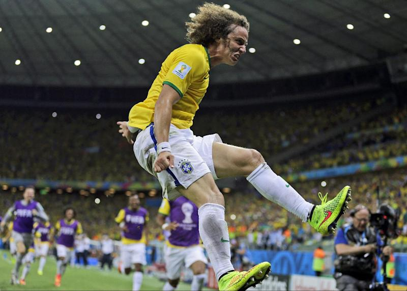 Brazil's David Luiz celebrates after scoring his side's second goal on a free kick during the World Cup quarterfinal soccer match between Brazil and Colombia at the Arena Castelao in Fortaleza, Brazil, Friday, July 4, 2014