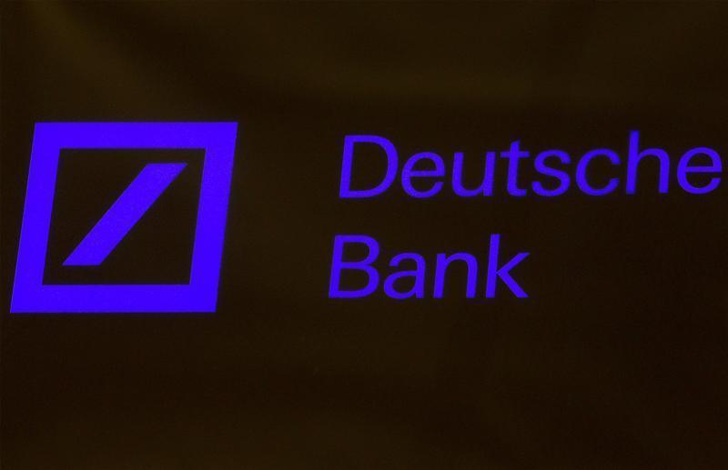 A Deutsche Bank sign is seen on the floor of the New York Stock Exchange