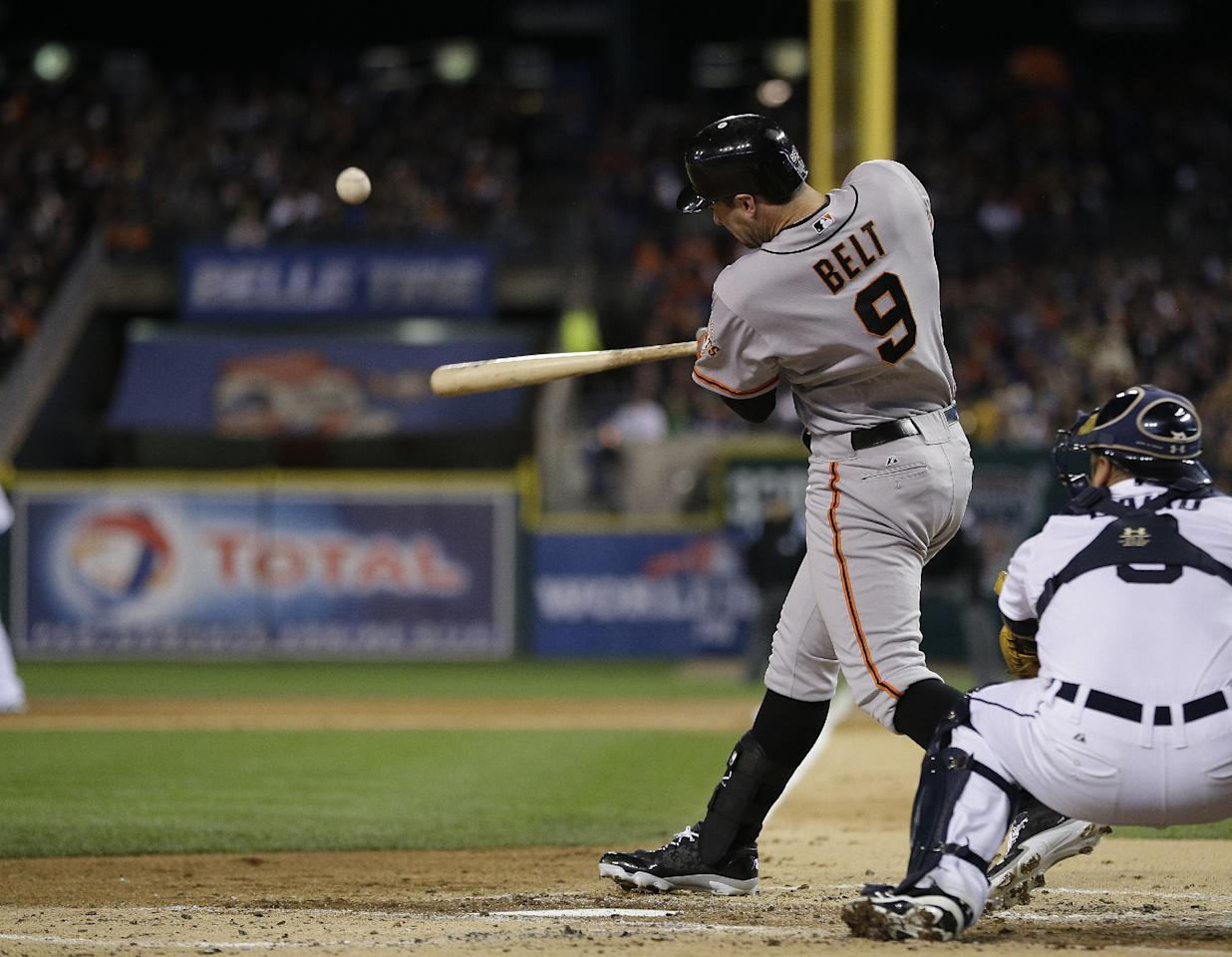 San Francisco Giants' Brandon Belt hits an RBI double during the second inning of Game 4 of baseball's World Series against the Detroit Tigers Sunday, Oct. 28, 2012, in Detroit. (AP Photo/Matt Slocum)