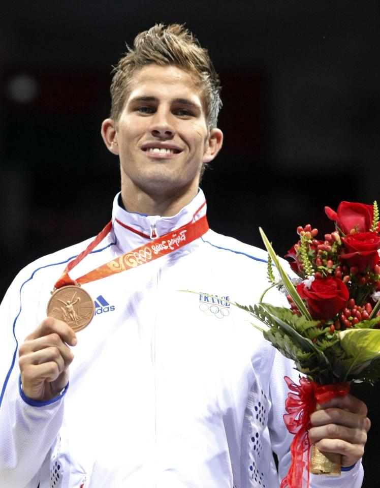 Alexis Vastine of France celebrates with his bronze medal during the medal ceremony after the men's light welterweight (64kg) final boxing match at the Beijing 2008 Olympic Games in this August 23, 2008 file photo. French President Francois Hollande's office confirmed on March 10, 2015 that eight French nationals were among 10 killed in an accident involving two helicopters in Argentina. The Elysee Palace said in a statement that famed sailor Florence Arthaud, Olympic swimmer Camille Muffat and boxer Vastine were among the dead. It added that the accident happened during the filming of a TV programme for the TF1 TV channel.     REUTERS/Lee Jae-Won/Files (CHINA - Tags: SPORT OLYMPICS BOXING OBITUARY DISASTER TRANSPORT)