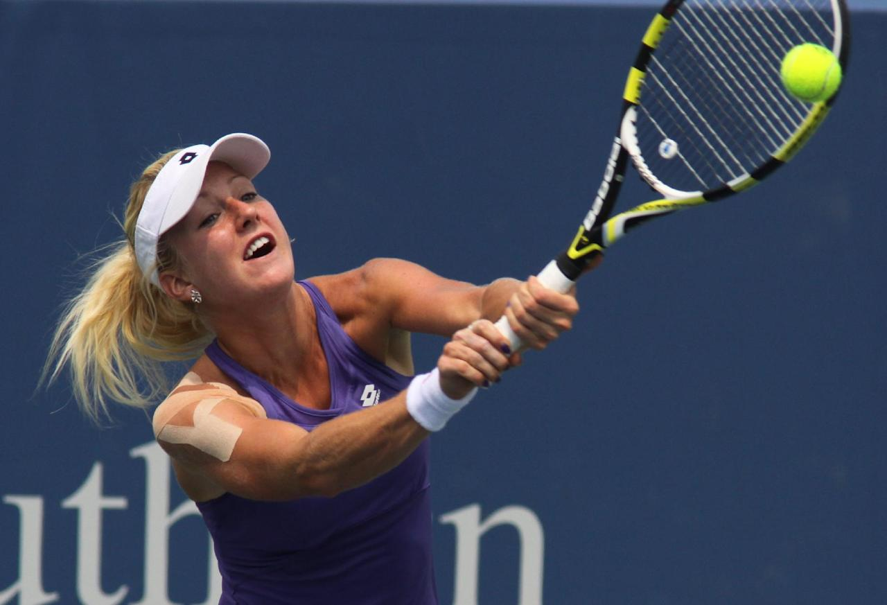 Urszula Radwanska, of Poland, returns a volley to Serena Williams, during a match at the Western & Southern Open tennis tournament, Thursday Aug. 16, 2012, in Mason, Ohio. (AP Photo/Tom Uhlman)
