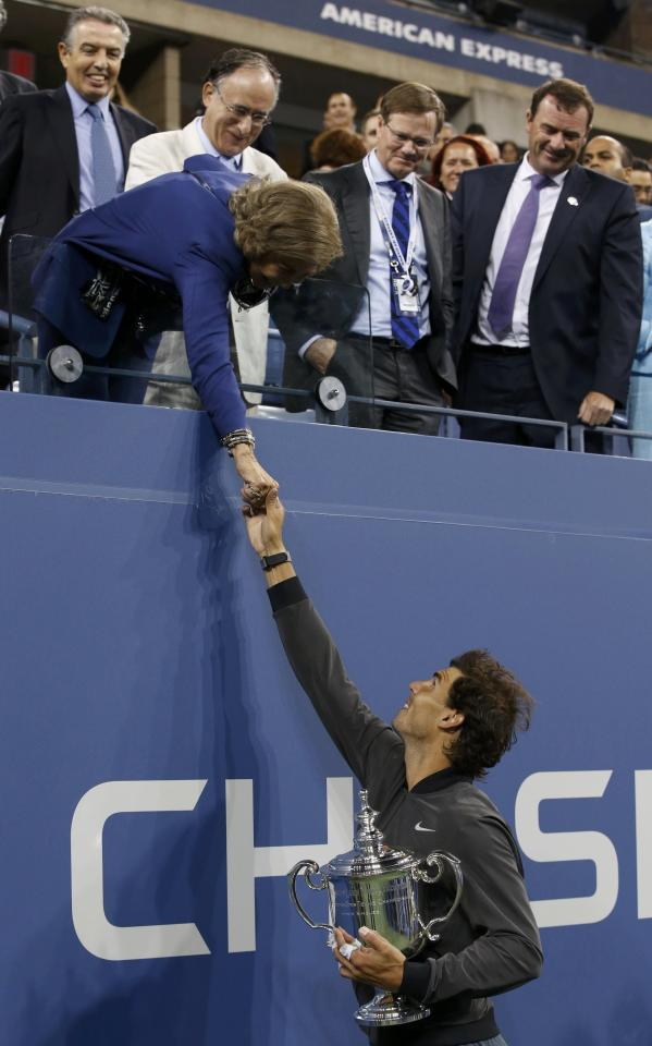 Rafael Nadal of Spain holds his trophy as he shakes hands with Queen Sofia of Spain after defeating Novak Djokovic of Serbia in their men's final match at the U.S. Open tennis championships in New York, September 9, 2013. REUTERS/Mike Segar (UNITED STATES - Tags: SPORT TENNIS)