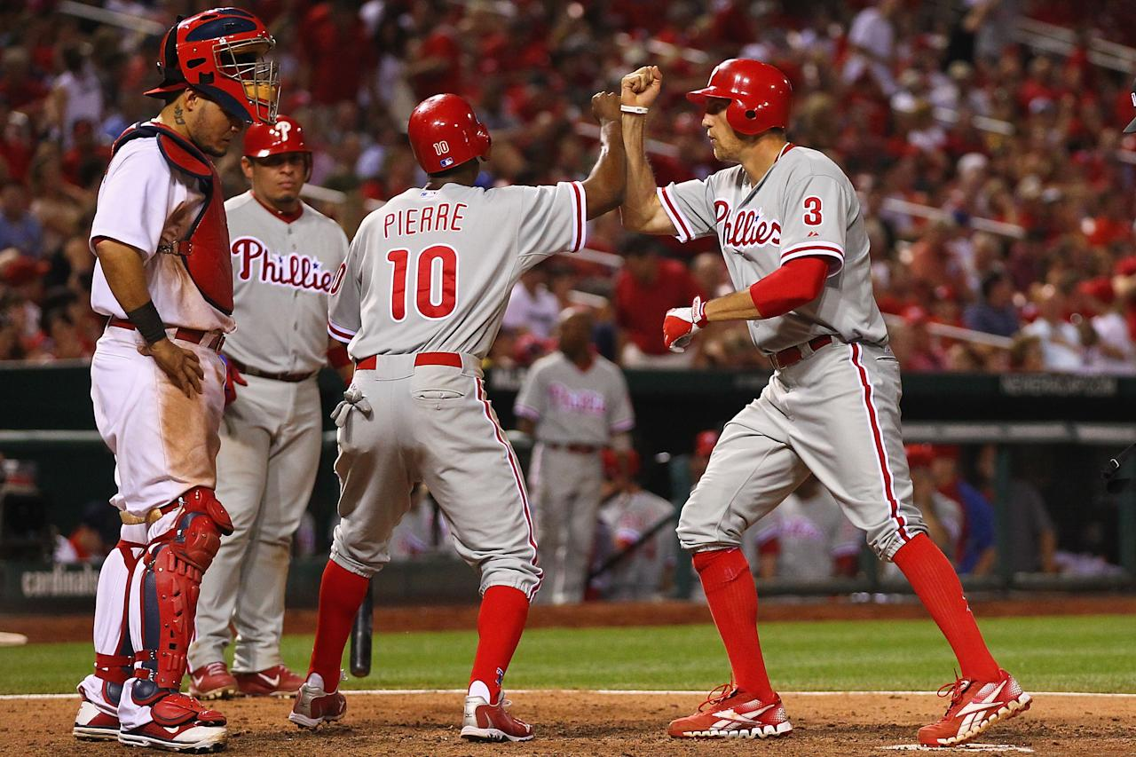 ST. LOUIS, MO - MAY 25: Hunter Pence #3 of the Philadelphia Phillies is congratulated by Juan Pierre #10 of the Philadelphia Phillies after Pence hit the game-winning home run in the tenth inning as Yadier Molina #4 of the St. Louis Cardinals looks on at Busch Stadium on May 25, 2012 in St. Louis, Missouri.  (Photo by Dilip Vishwanat/Getty Images)