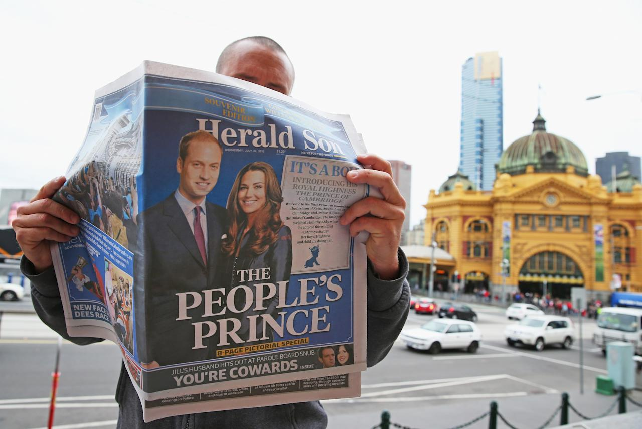 MELBOURNE, AUSTRALIA - JULY 24: In this photo illustration, a man reads a copy of the local Melbourne newspaper 'The Herald Sun' showing the reaction to the birth of the Duke And Duchess Of Cambridge's new son, on July 24, 2013 in Melbourne, Australia. The Duchess of Cambridge yesterday gave birth to a boy at 16.24 BST and weighing 8lb 6oz, with Prince William at her side. The baby, as yet unnamed, is third in line to the throne and becomes the Prince of Cambridge. (Photo by Scott Barbour/Getty Images)