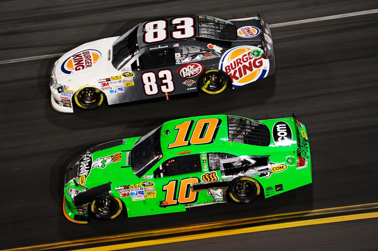 DAYTONA BEACH, FL - FEBRUARY 27:  Landon Cassill, driver of the #83 Burger King Toyota, and Danica Patrick, driver of the #10 GoDaddy.com Chevrolet, race during the NASCAR Sprint Cup Series Daytona 500 at Daytona International Speedway on February 27, 2012 in Daytona Beach, Florida.  (Photo by John Harrelson/Getty Images for NASCAR)
