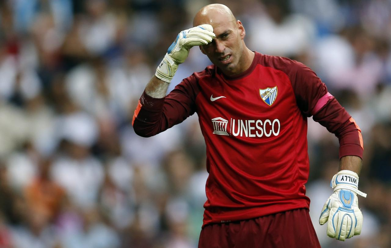 Malaga's goalkeeper Wilfredo Caballero reacts during the Spanish first division soccer match against Real Madrid at Santiago Bernabeu stadium in Madrid October 19, 2013. REUTERS/Javier Barbancho (SPAIN - Tags: SPORT SOCCER)