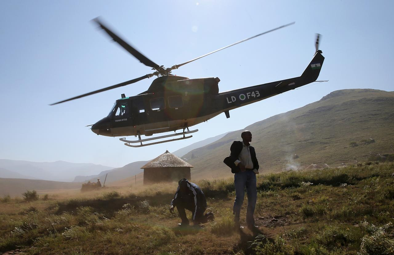 MOKHOTLONG, LESOTHO - FEBRUARY 26: A helicopter carrying Sentebale staff leave a herd boy school refurbished by Sentebale during a visit by Sentebale staff on February 26, 2013 in Mokhotlong, Lesotho. Sentebale is a charity founded by Prince Harry and Prince Seeiso of Lesotho. It helps the most vulnerable children in Lesotho get the support they need to lead healthy and productive lives. Prince Harry is due to pay a visit to Lesotho this week to catch up on his charity's progress and meet key children who will be supported by the charity.  (Photo by Chris Jackson/Getty Images)