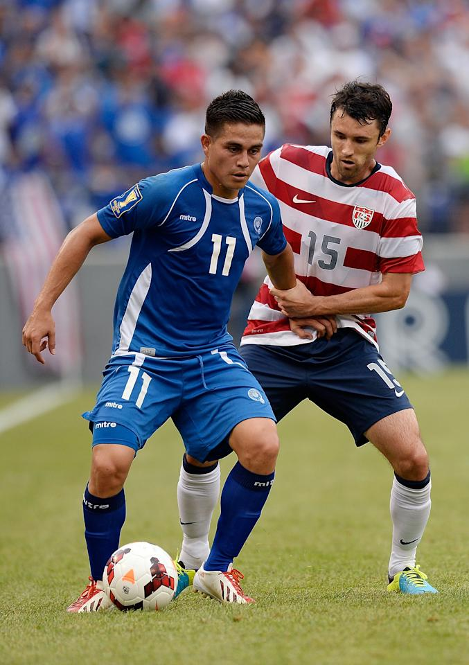 BALTIMORE, MD - JULY 21: Rodolfo Zelaya Garcia #11 of El Salvador battles for the ball against Michael Parkhurst #15 of the United States in the first half during the 2013 CONCACAF Gold Cup quarterfinal game at M&T Bank Stadium on July 21, 2013 in Baltimore, Maryland. (Photo by Patrick McDermott/Getty Images)