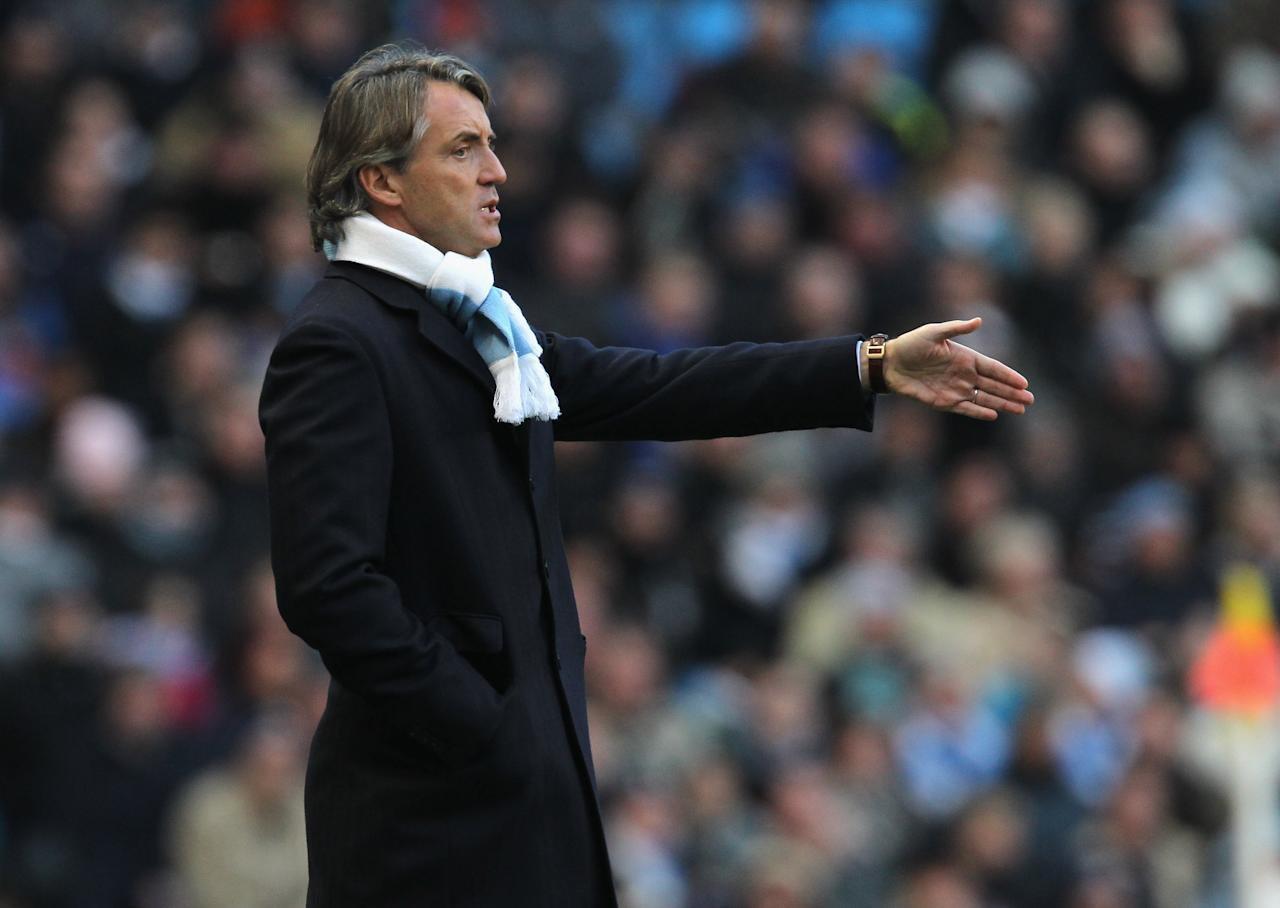 MANCHESTER, ENGLAND - DECEMBER 26:  Roberto Mancini the manager of Manchester City looks on during the Barclays  Premier League match between Manchester City and Stoke City at City of Manchester Stadium on December 26, 2009 in Manchester, England.  (Photo by Alex Livesey/Getty Images)