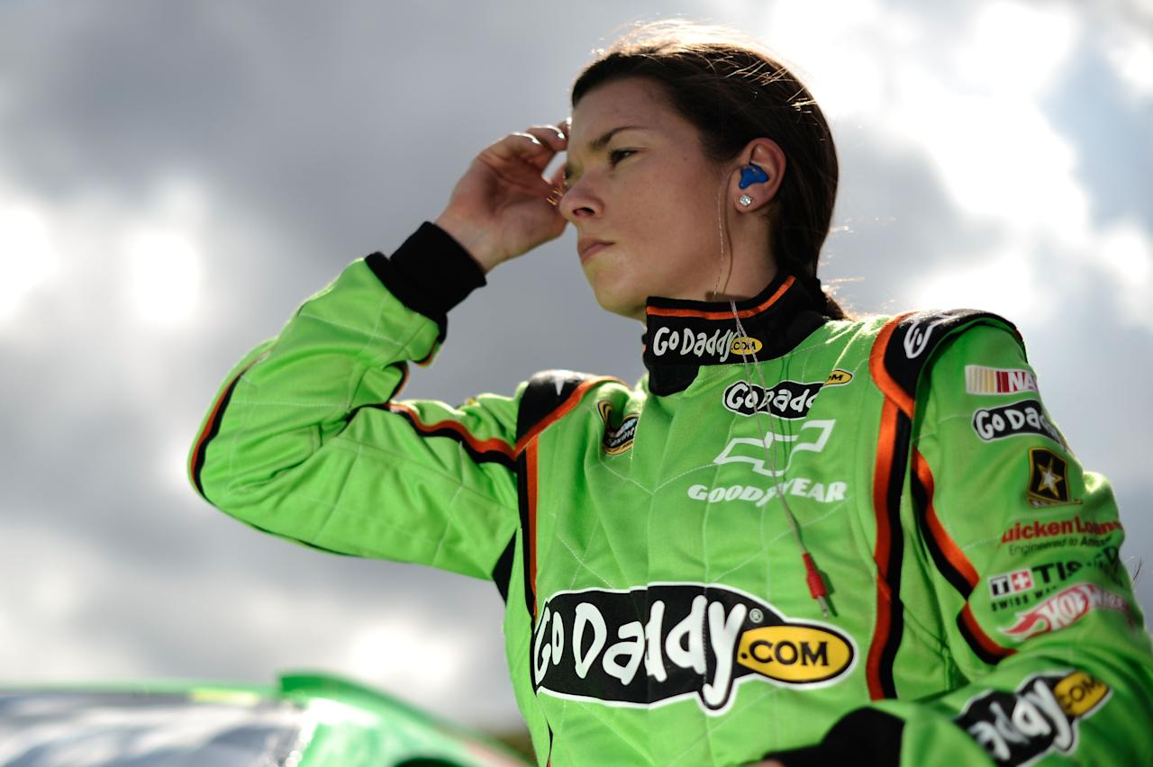 DAYTONA BEACH, FL - FEBRUARY 19:  Danica Patrick, driver of the #10 GoDaddy.com Chevrolet, gets out of her car after qualifying for the NASCAR Sprint Cup Series Daytona 500 at Daytona International Speedway on February 19, 2012 in Daytona Beach, Florida.  (Photo by Jared C. Tilton/Getty Images for NASCAR)