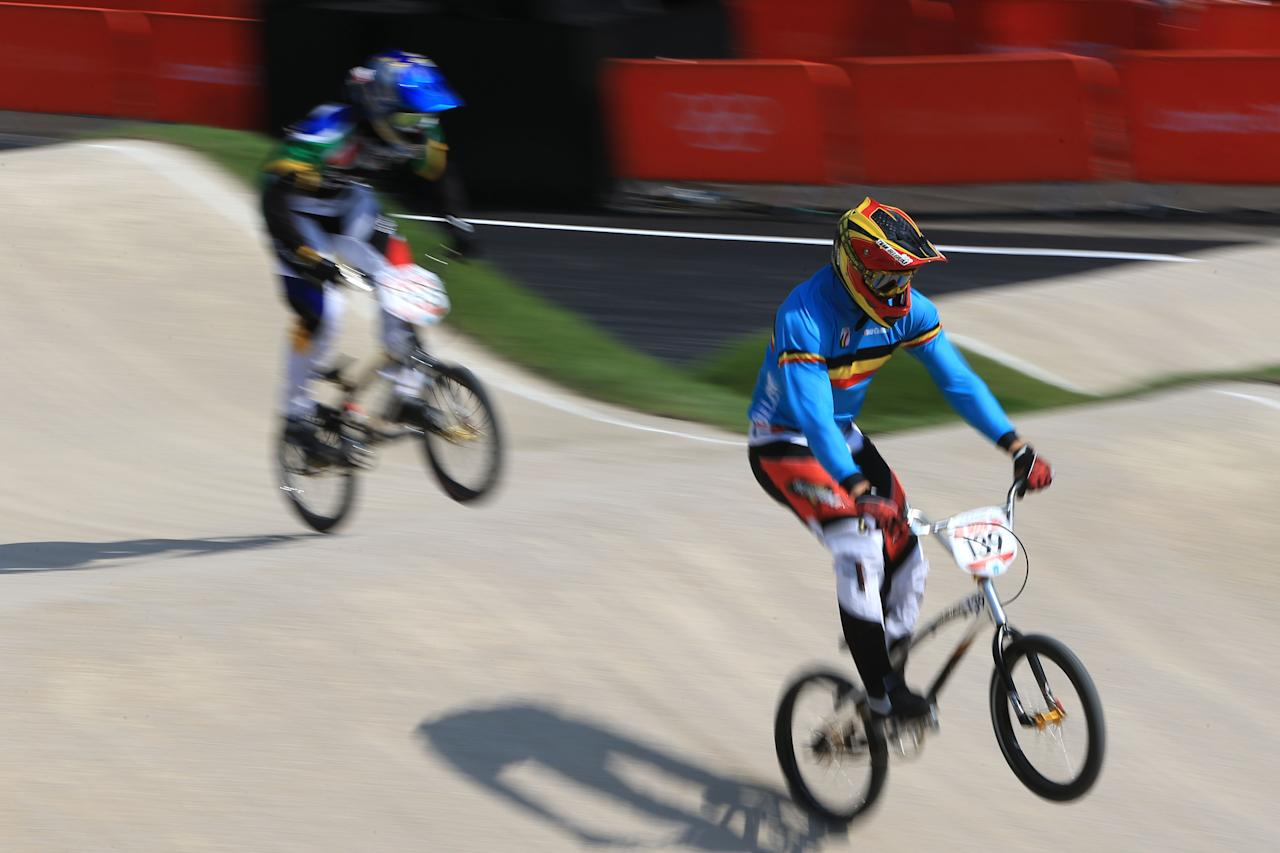 LONDON, ENGLAND - AUGUST 09:  Arnaud Dubois of Belgium (R) pumps through a section during the Men's BMX Cycling Quarter Finals on Day 13 of the London 2012 Olympic Games at BMX Track on August 9, 2012 in London, England.  (Photo by Phil Walter/Getty Images)