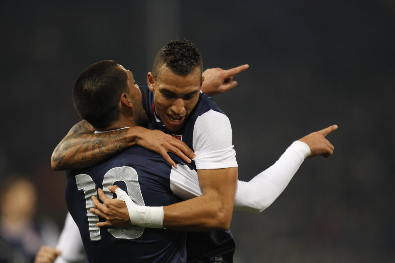 US forward Clint Dempsey, left, celebrates with his teammate midfielder Danny Williams after scoring during a friendly soccer match between Italy and USA, at the Genoa Luigi Ferraris stadium, Italy, Wednesday, Feb. 29, 2012. USA won 1-0. (AP Photo/Luca Bruno)