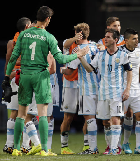 Argentina's Lionel Messi, right, greets Belgium's goalkeeper Thibaut Courtois at the end of the World Cup quarterfinal soccer match between Argentina and Belgium at the Estadio Nacional in Brasilia, Brazil, Saturday, July 5, 2014. Argentina won 1-0. (AP Photo/Thanassis Stavrakis)