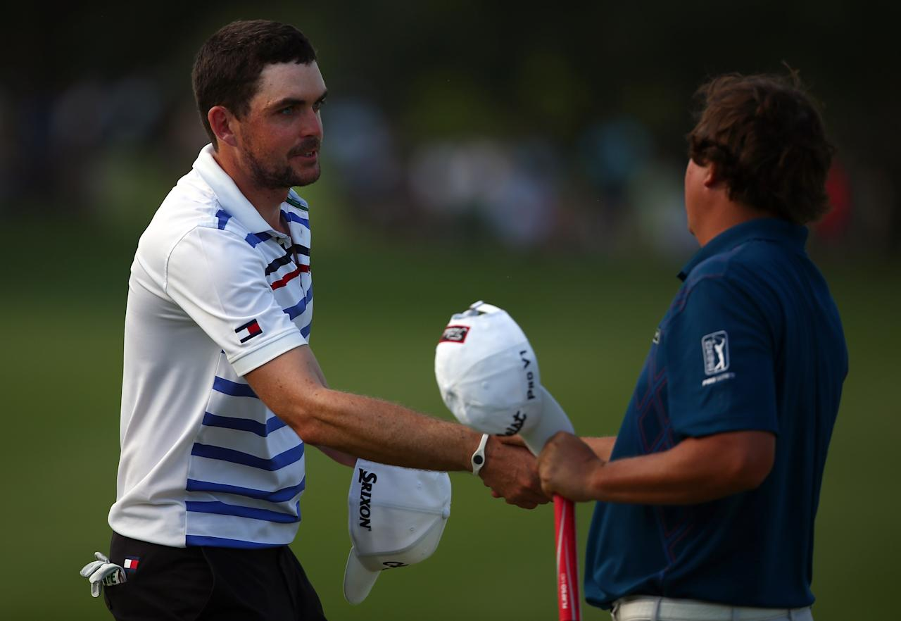 IRVING, TX - MAY 17:  Keegan Bradley shakes hands with Jason Dufner after finishing the second round of the 2013 HP Byron Nelson Championship at the TPC Four Seasons Resort on May 17, 2013 in Irving, Texas.  (Photo by Tom Pennington/Getty Images)