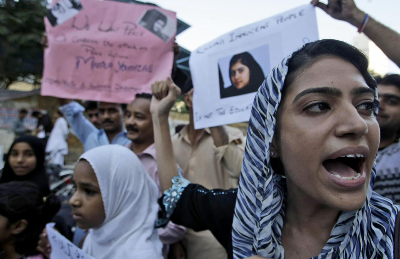 Pakistanis chant slogans during a demonstration to condemn the attack on 14-year-old schoolgirl Malala Yousufzai, who was shot on Tuesday by the Taliban for speaking out in support of education for women, in Karachi, Pakistan, Thursday, Oct. 11, 2012. (AP Photo/Fareed Khan)