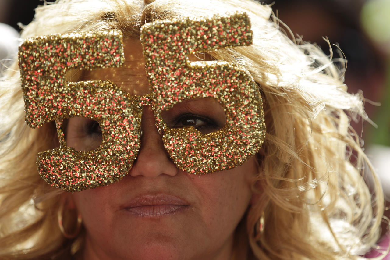 Annette Kush, of San Diego, wears No. 55 eyeglasses during a public memorial service for football player Junior Seau at Qualcomm Stadium, Friday, May 11, 2012, in San Diego. Seau committed suicide on May 2 at his Oceanside, Calif., home. He played parts of 20 seasons in the NFL, with the San Diego Chargers, Miami Dolphins and New England Patriots. (AP Photo/ Gregory Bull)