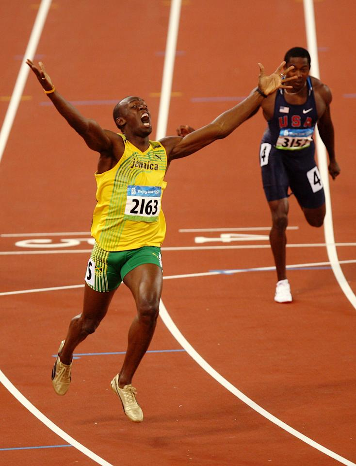 Usain Bolt of Jamaica reacts after breaking the world record with a time of 19.30 to win the gold medal in the men's 200m final during the track and field athletics event at the National Stadium during Day 12 of the Beijing 2008 Olympic Games on August 20, 2008 in Beijing, China. (Photo by Adam Pretty/Getty Images)