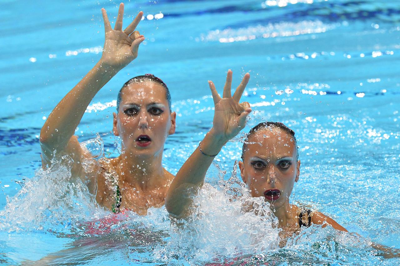 Italy's Giulia Lapi and Italy's Mariangela Perrupato compete in the duets free routine final during the synchronised swimming competition at the London 2012 Olympic Games on August 7, 2012 in London.  AFP PHOTO / ALBERTO PIZZOLIALBERTO PIZZOLI/AFP/GettyImages