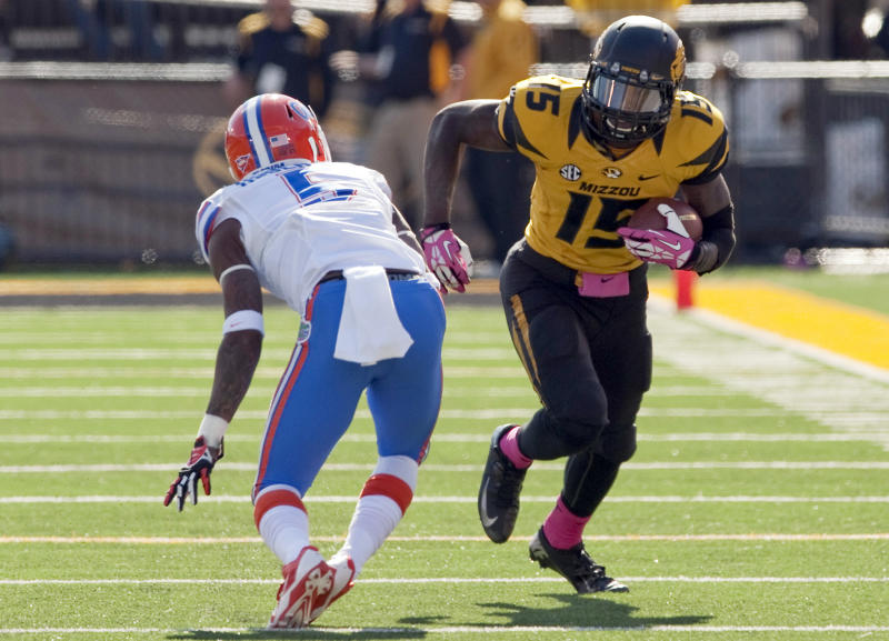 In this Oct. 19, 2013, file photo, Missouri wide receiver Dorial Green-Beckham runs as Florida Gators defensive back Marcus Roberson defends during the fourth quarter of an NCAA college football game in Columbia, Mo. Green-Beckham has been suspended indefinitely for an unspecified violation of team rules, three months after he and two friends were arrested on suspicion of felony drug distribution. Coach Gary Pinkel announced the suspension Monday, April 7, 2014, in a brief news release