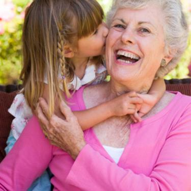 Grandmother-getting-a-kiss-from-granddaughter_web