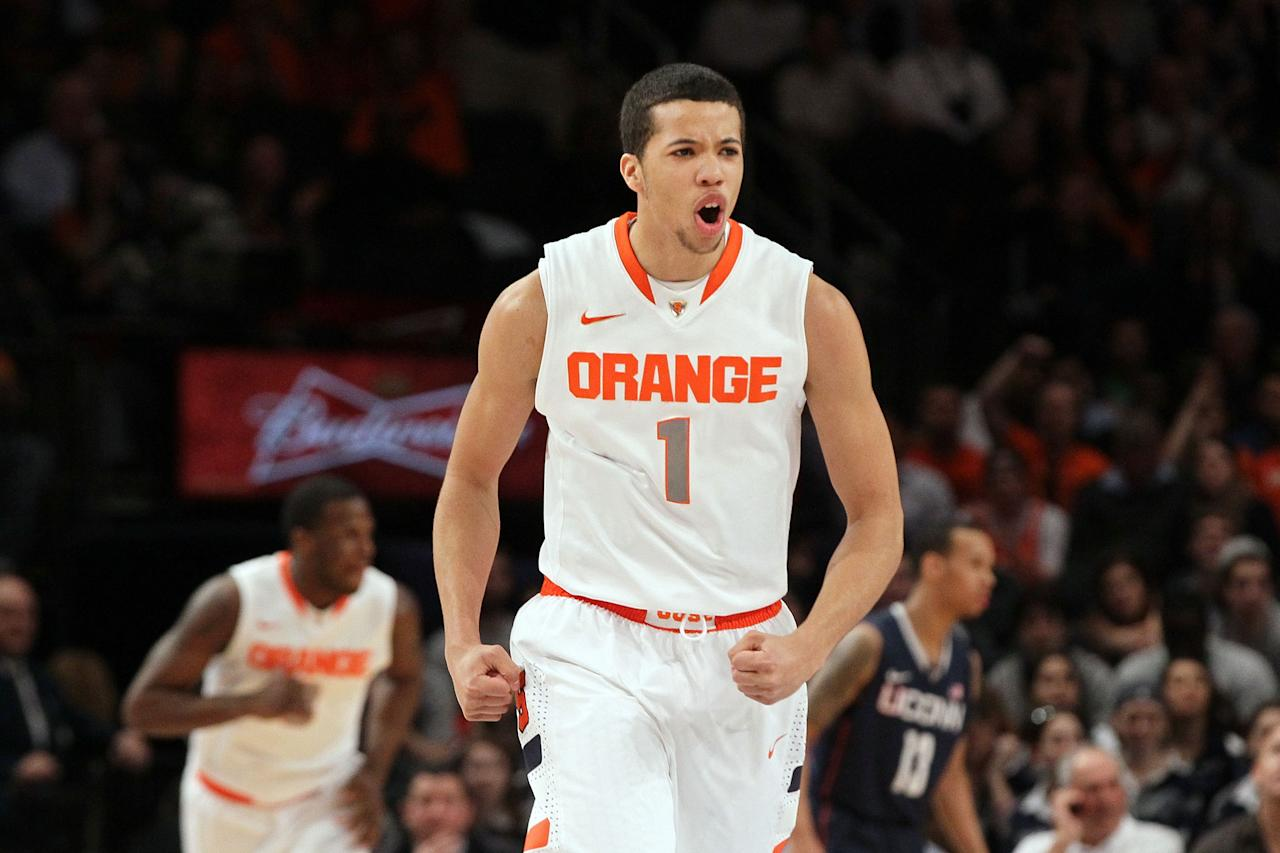 NEW YORK, NY - MARCH 08:  Michael Carter-Williams #1 of the Syracuse Orange reacts after a play against the Connecticut Huskies during the quarterfinals of the Big East Men's Basketball Tournament at Madison Square Garden on March 8, 2012 in New York City.  (Photo by Jim McIsaac/Getty Images)