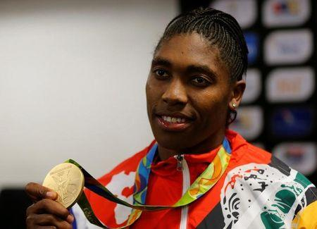 South Africa's Rio 2016 Summer Olympic Games gold medalist, Caster Semenya shows her medal after arriving at the O. R. Tambo International Airport in Johannesburg, South Africa August 23, 2016. REUTERS/Siphiwe Sibeko