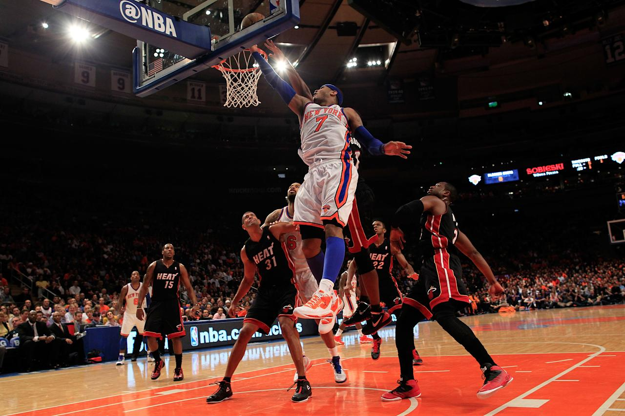 NEW YORK, NY - APRIL 15: Carmelo Anthony #7 of the New York Knicks lays the ball up against the Miami Heat at Madison Square Garden on April 15, 2012 in New York City. NOTE TO USER: User expressly acknowledges and agrees that, by downloading and/or using this Photograph, user is consenting to the terms and conditions of the Getty Images License Agreement.  (Photo by Chris Trotman/Getty Images)