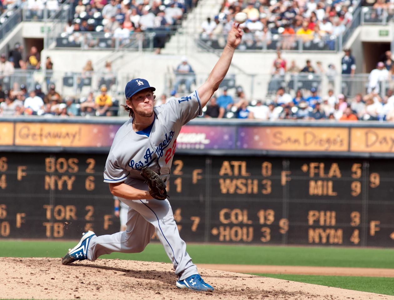 SAN DIEGO, CA - SEPTEMBER 25: Clayton Kershaw #22 of the Los Angeles Dodgers throws the ball during the 8th inning on his way recording his 21st win of the season during the game against the San Diego Padres at Petco Park on September 25, 2011 in San Diego, California. (Photo by Kent C. Horner/Getty Images)