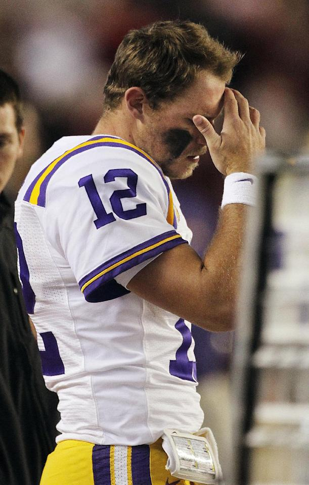 LSU quarterback Jarrett Lee (12) reacts on the sidelines after an throwing an interception against Alabama during the second half of an NCAA college football game, Saturday, Nov. 5, 2011, in Tuscaloosa, Ala. (AP Photo/Dave Martin)