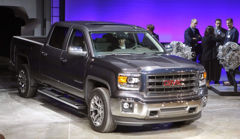 General Motors displays its 2014 GMC Sierra full-size pickup truck after unveiling it and the 2014 Chevrolet Silverado full-size pickup truck in Pontiac, Michigan in this file photo