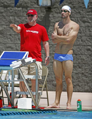 Coach Bob Bowman keeps meticulous training notes without much help from a computer. (USA TODAY Sports)