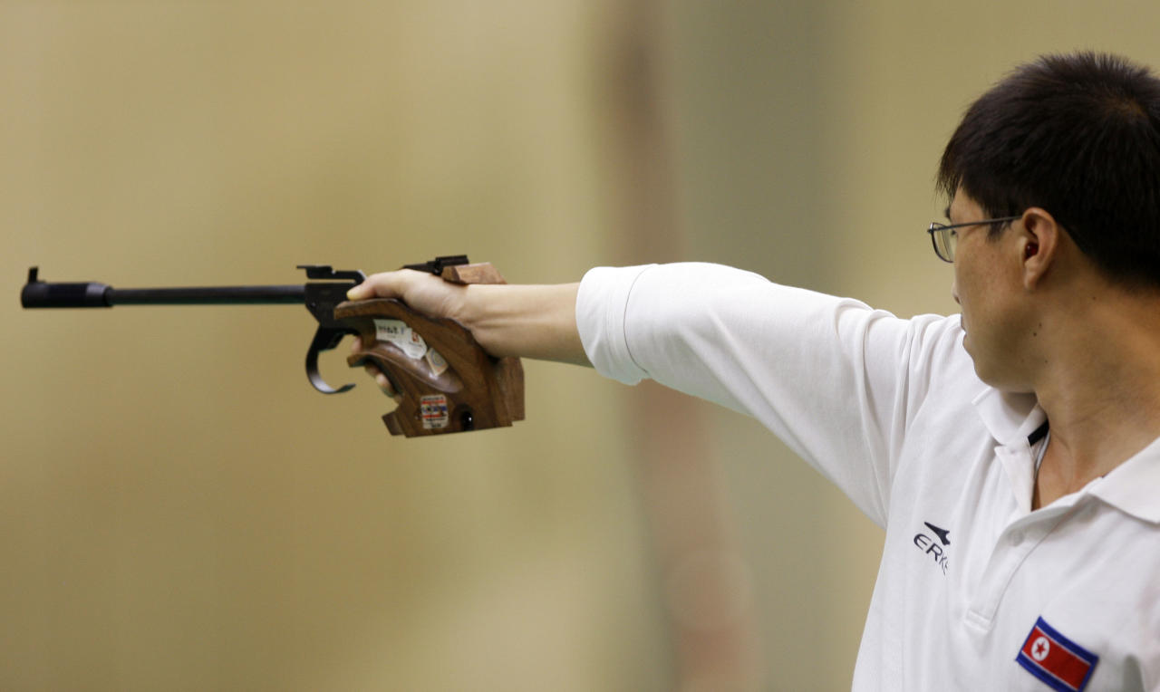 At the 2008 Beijing Games, North Korean sport shooter Kim Jong-su earned a bronze medal in the 10-meter air pistol event and a silver medal in the 50-meter air pistol event. Three days later, he tested positive for propranolol, a drug designed to calm nerves, and thusly forfeited both medals. (AP Photo/Charlie Riedel)
