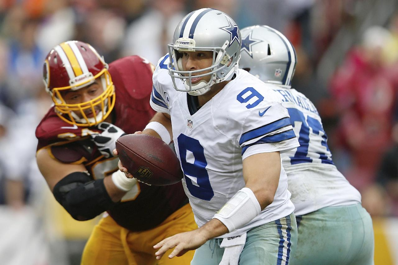 Dallas Cowboys quarterback Tony Romo scrambles out of the pocket during the second half of an NFL football game against the Washington Redskins in Landover, Md., Sunday, Dec. 22, 2013. (AP Photo/Evan Vucci)