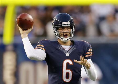 Bears' Cutler makes a pass against the Chargers during the first half of a pre-season NFL football game in Chicago