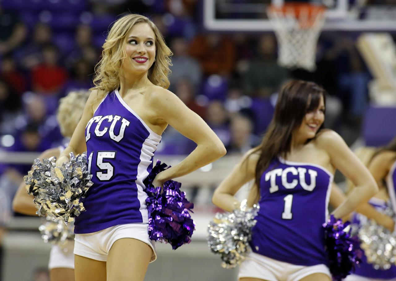 The TCU showgirls perform during the second half of an NCAA college basketball game against Texas Tuesday, Feb. 4, 2014, in Fort Worth, Texas. Texas beat TCU 59-54. (AP Photo/Sharon Ellman)