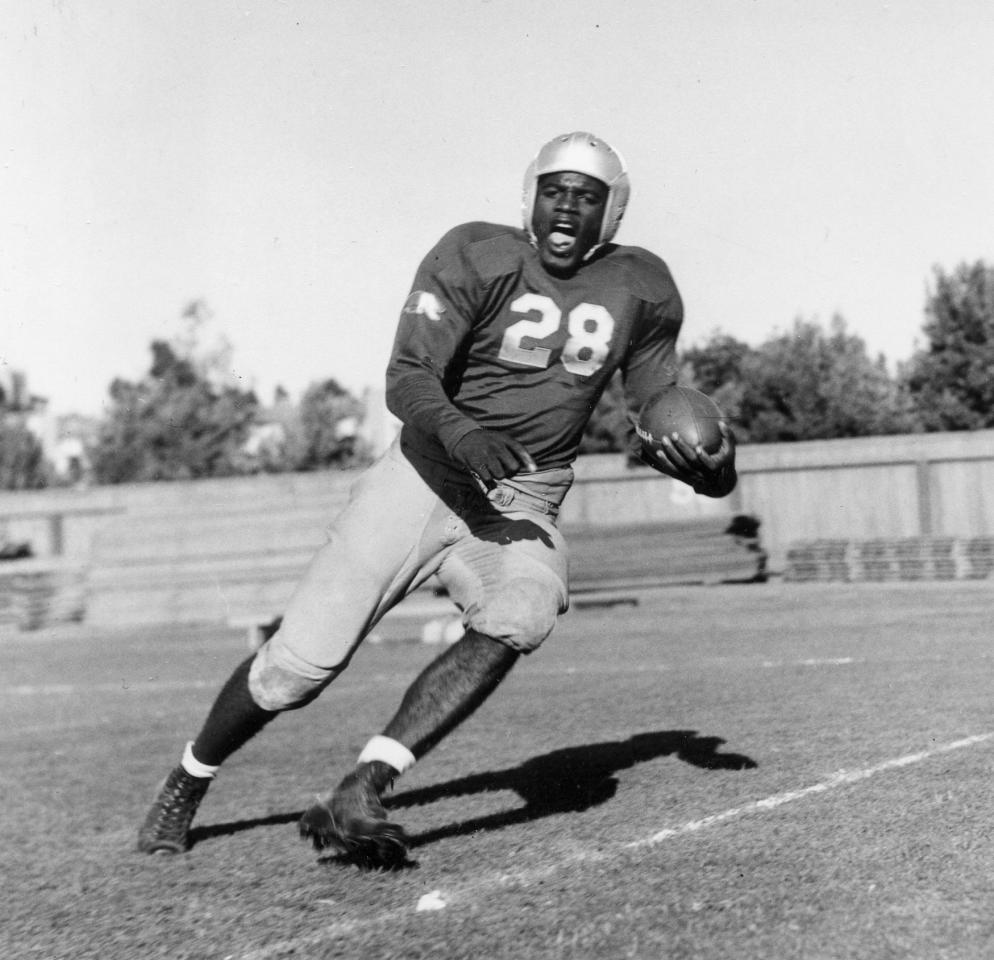 FILE - This Sept. 20, 1939, file photo shows Jackie Robinson during football training at the University of California campus in Westwood, Calif. Robinson lettered in football, basketball, baseball and track and field in college.