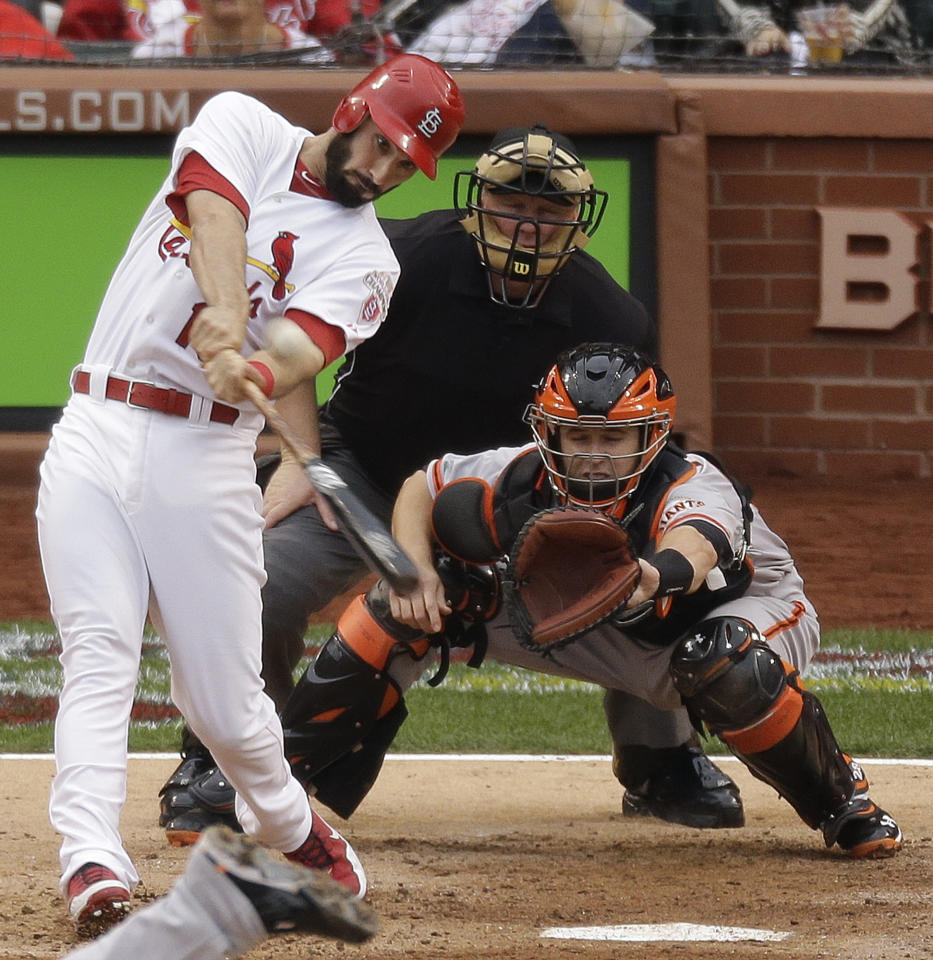 St. Louis Cardinals' Matt Carpenter (13) hits a two-run home run during the third inning of Game 3 of baseball's National League championship series against the San Francisco Giants, Wednesday, Oct. 17, 2012, in St. Louis. (AP Photo/Mark Humphrey)