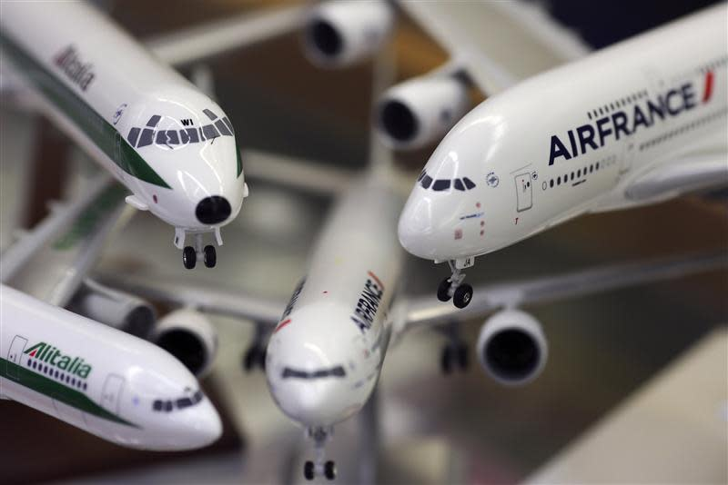 Scale models of Alitalia and Airfrance airplanes are displayed at a shop selling models of vehicles in Rome
