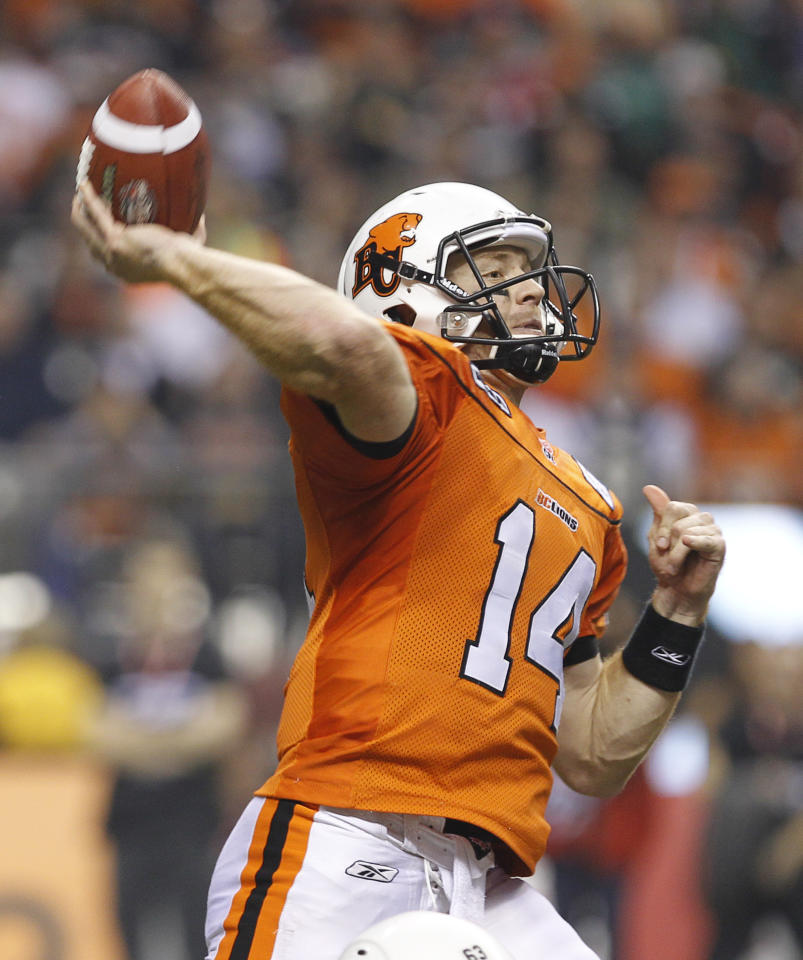 VANCOUVER, CANADA - NOVEMBER 27: Travis Lulay #14 of the BC Lions throws a pass against the  Winnipeg Blue Bombers during the  CFL 99th Grey Cup November 27, 2011 at BC Place in Vancouver, British Columbia, Canada. The Lions won 34-23.  (Photo by Jeff Vinnick/Getty Images)