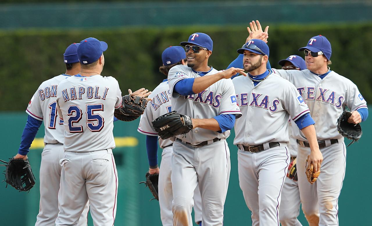 DETROIT, MI - APRIL 22: Mitch Moreland #18 of the Texas Rangers celebrates with his teammates after defeating the Detroit Tigers 3-2 at Comerica Park on April 22, 2012 in Detroit, Michigan (Photo by Leon Halip/Getty Images)