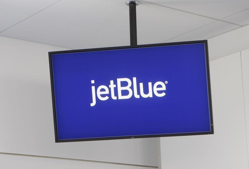 JetBlue Airways logo is displayed on a monitor in Terminal 5 at JFK International Airport in New York