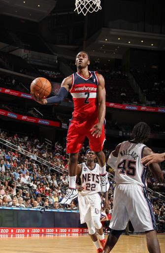 Nene has strong debut, leading Wizards over Nets