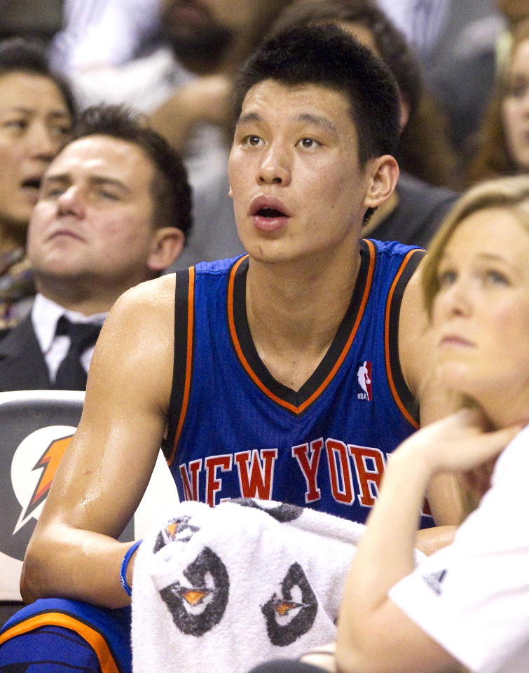New York Knicks Jeremy Lin watches action from the bench for most of the first half of their NBA basketball game against the Toronto Raptors in Toronto March 23, 2012.   REUTERS/Fred Thornhill (CANADA - Tags: SPORT BASKETBALL)
