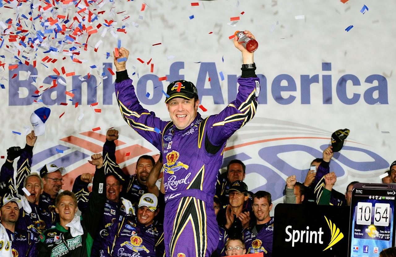 CHARLOTTE, NC - OCTOBER 15:  Matt Kenseth, driver of the #17 Fluidmaster Ford, celebrates in Victory Lane after winning the NASCAR Sprint Cup Series Bank of America 500 at Charlotte Motor Speedway on October 15, 2011 in Charlotte, North Carolina.  (Photo by Jason Smith/Getty Images for NASCAR)