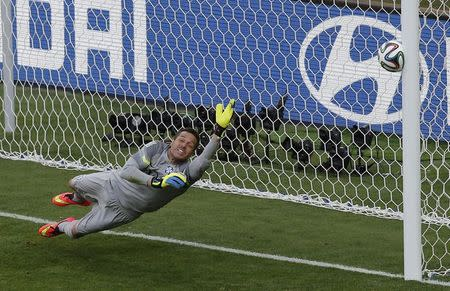 Brazil's goalkeeper Cesar dives as the decisive penalty shot by Chile's Jara hits the goalpost in the penalty shootout during their 2014 World Cup round of 16 game at the Mineirao stadium in Belo Horizonte