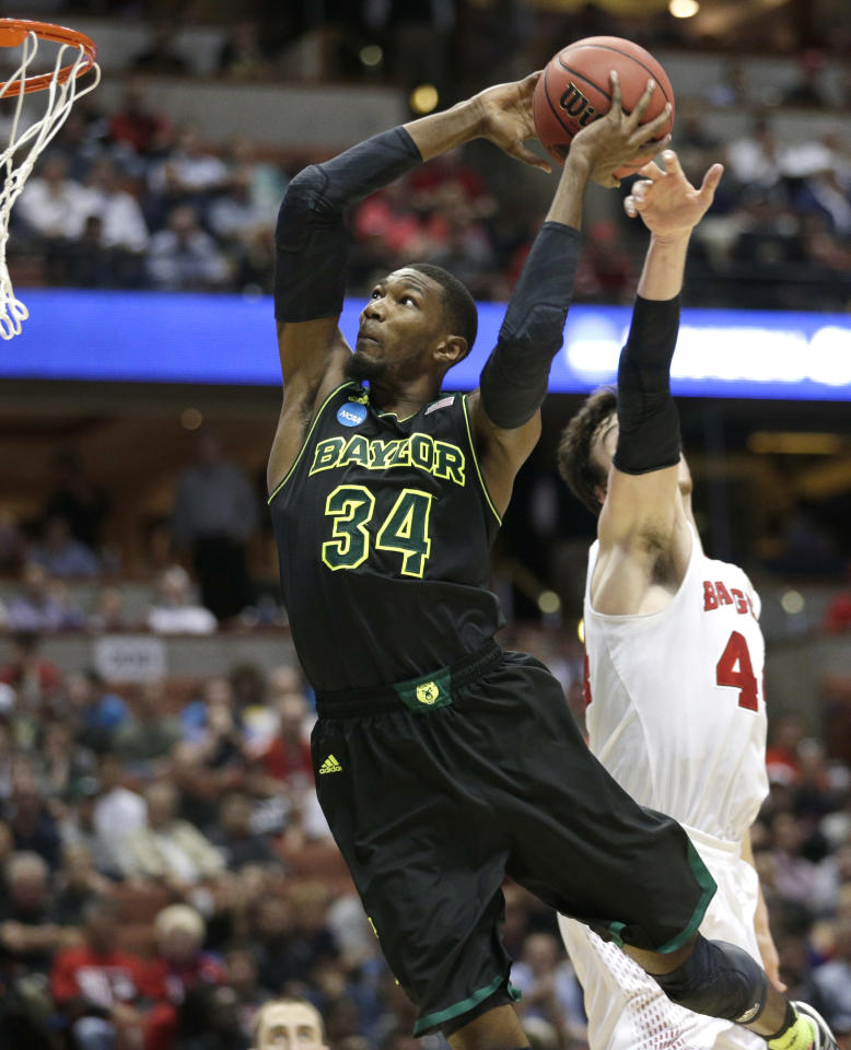 Wisconsin forward Frank Kaminsky right, can't stop Baylor forward Cory Jefferson (34) from dunking during the second half of an NCAA men's college basketball tournament regional semifinal, Thursday, March 27, 2014, in Anaheim, Calif. (AP Photo/Jae C. Hong)
